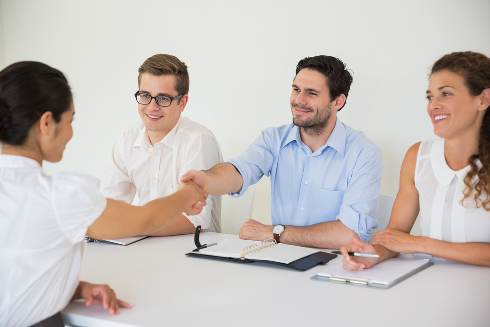 Business people shaking hands during job recruitment meeting in office