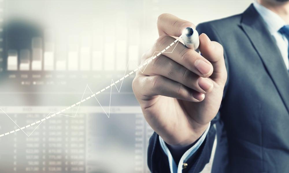 Businessman hand drawing increasing graph on media screen-2
