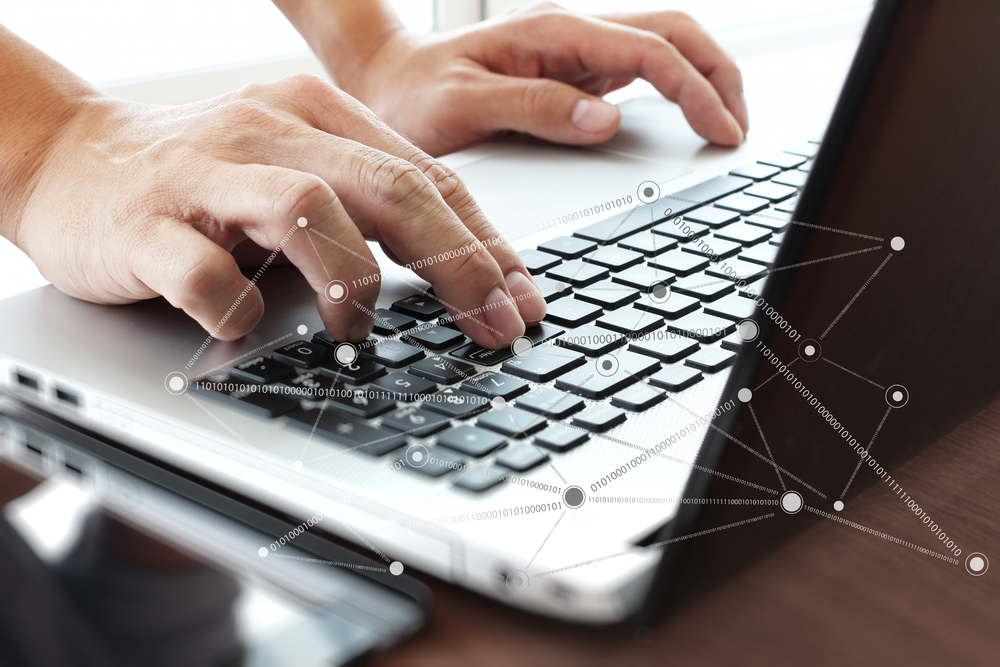 Close up of business man hand working on laptop computer with social network diagram on wooden desk as concept-1