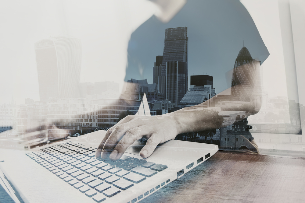 Double exposure of businessman working with new modern computer-1