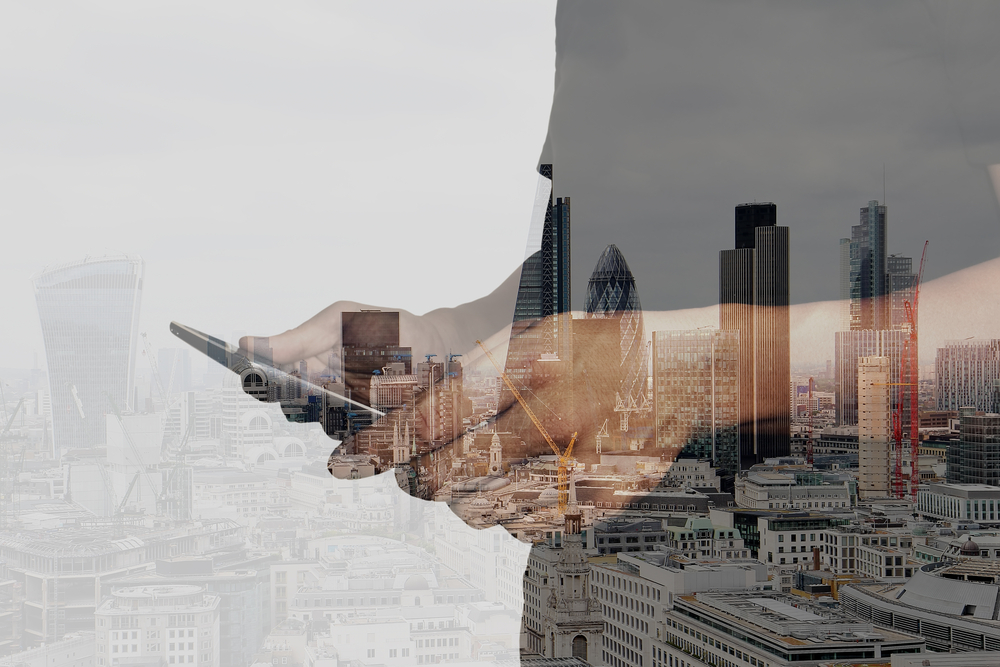Double exposure of success businessman using digital tablet with london building and social media diagram-2