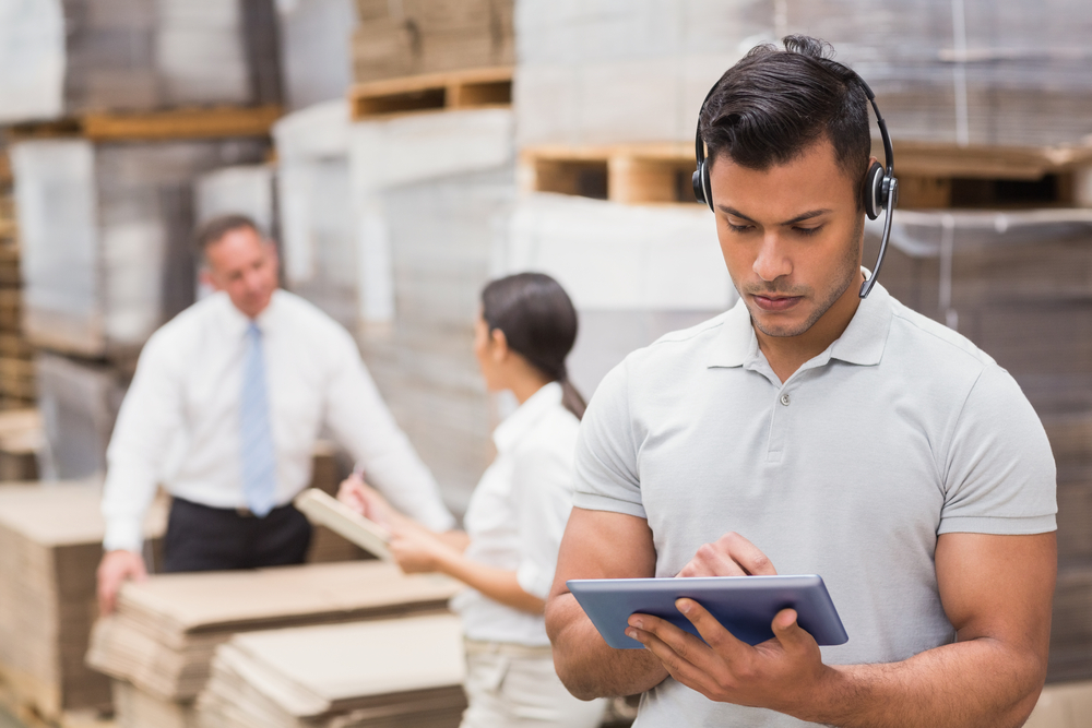 Female manager using digital tablet in warehouse-1
