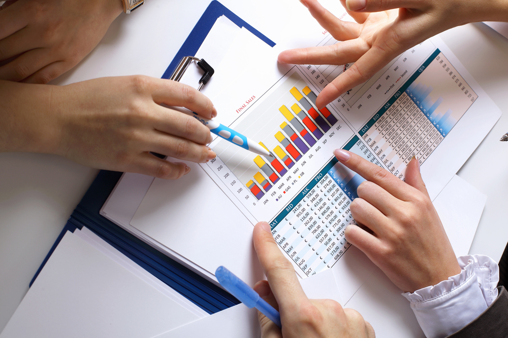 Financial paper charts and graphs on the table-2