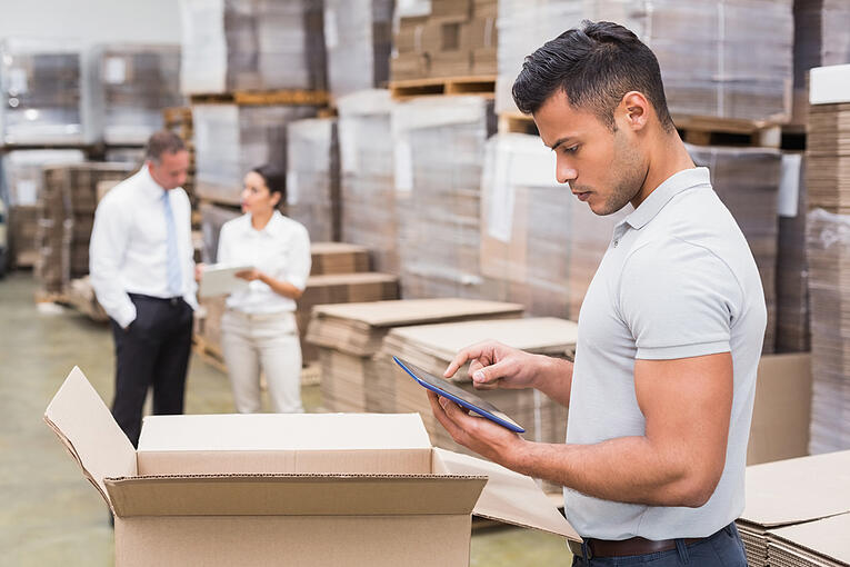 Portrait of male manager using digital tablet in warehouse-2