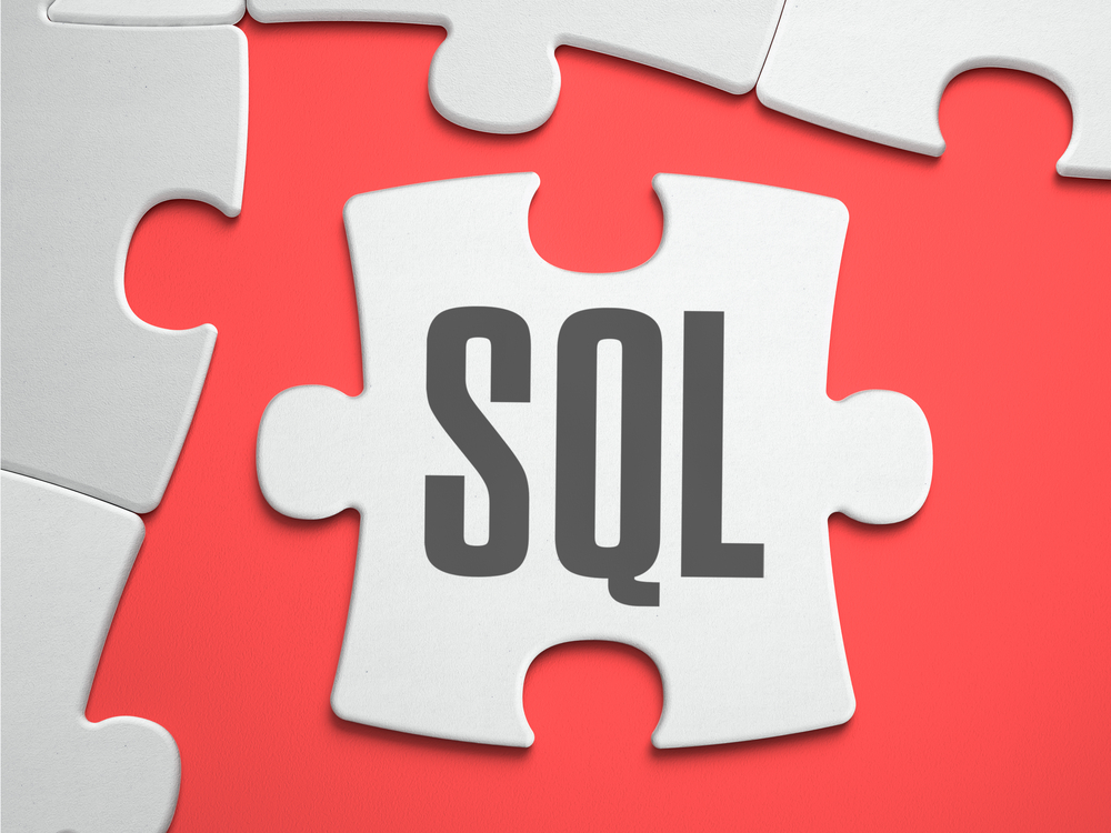 SQL - Structured Query Language - Text on Puzzle on the Place of Missing Pieces. Scarlett Background. Close-up. 3d Illustration.