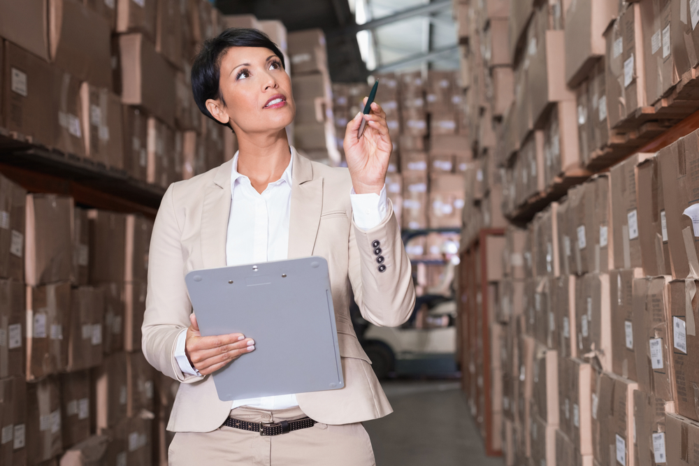 Warehouse manager checking her inventory in a large warehouse-1