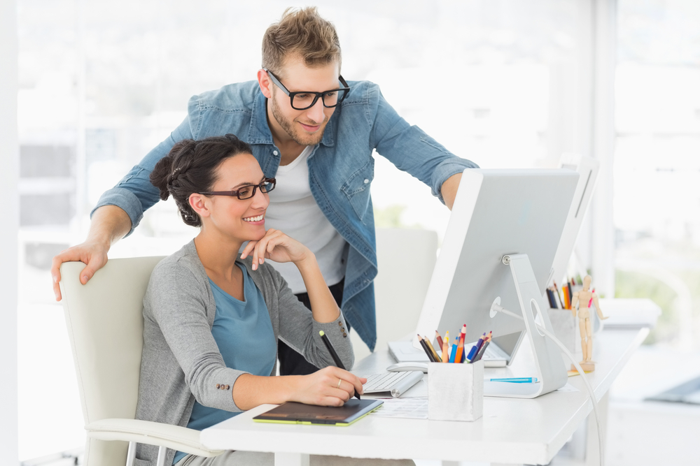 Young design team working at desk in creative office-2