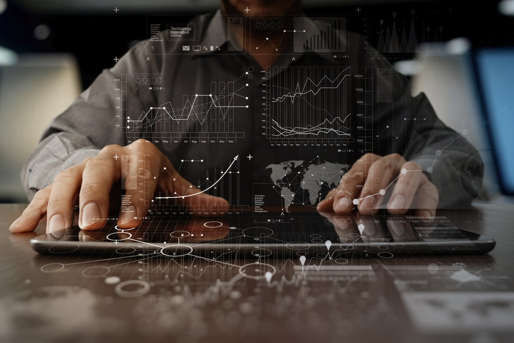 businessman hand working on laptop computer with digital layer business strategy and social media diagram on wooden desk-1