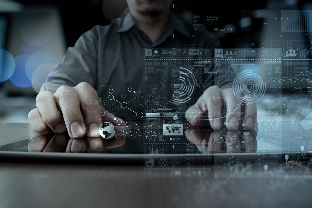 businessman hand working with modern technology digital tablet computer and graphics layer effect as business strategy concept-1