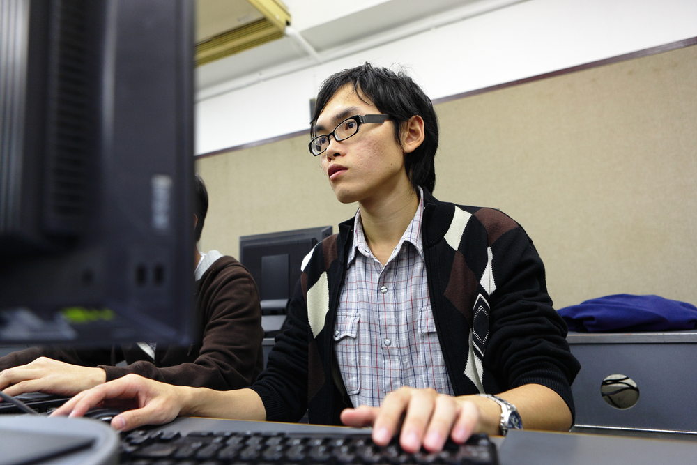 student studying in computer room