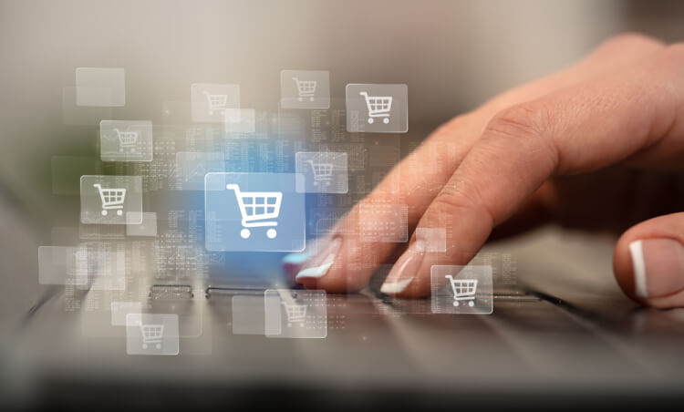 Business woman hand typing on keyboard with online shopping concept