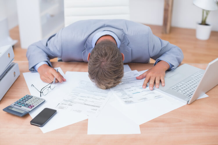 Businessman being depressed by accounting in his office-1
