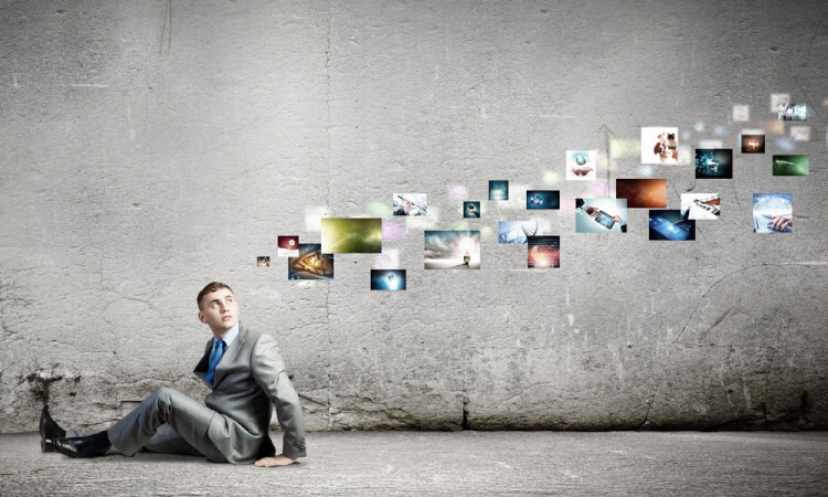 Image of young man sitting on floor looking on media icons-1