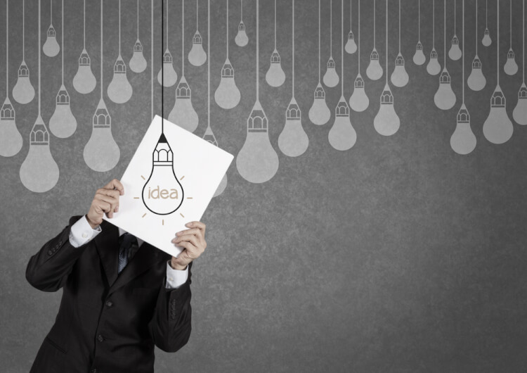 businessman showing the book of drawing idea light bulb concept creative design